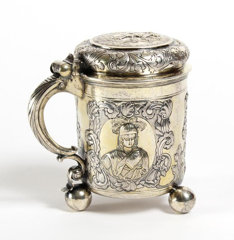 18TH CENTURY SILVER TANKARD RUSSIAN LEADERS - Moscow 1740s - A large, lidded Russian silver tankard with repousse designs around the...