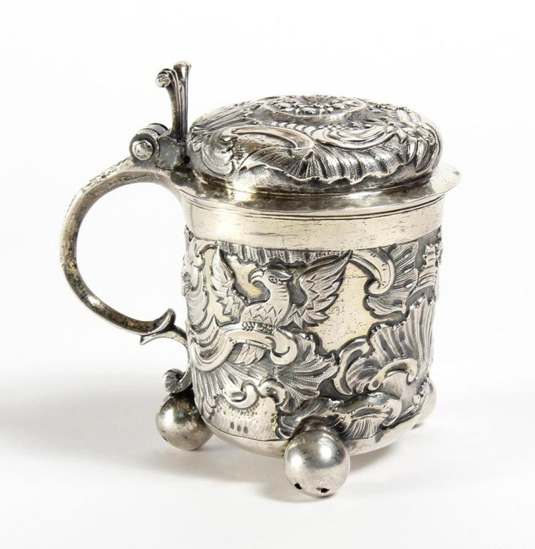 18TH CENTURY RUSSIAN SILVER TANKARD - 1758 Moscow - Lidded silver Russian tankard with repoussed floral and avian designs. Silver is...