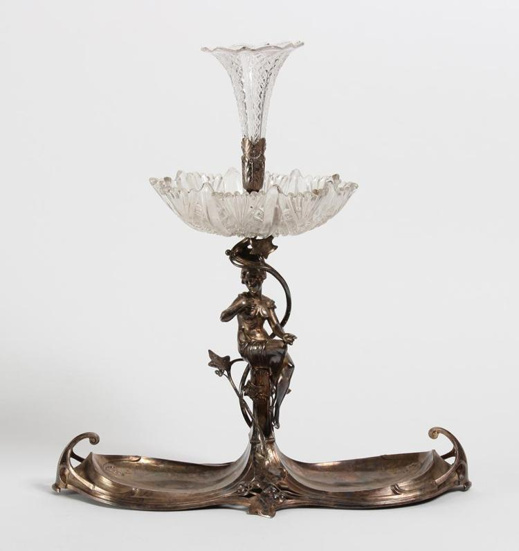 FIGURAL SILVERPLATE ART NOUVEAU EPERGNE - A seated figure of a young maiden entwined with leaves and berries supports a pressed glas...