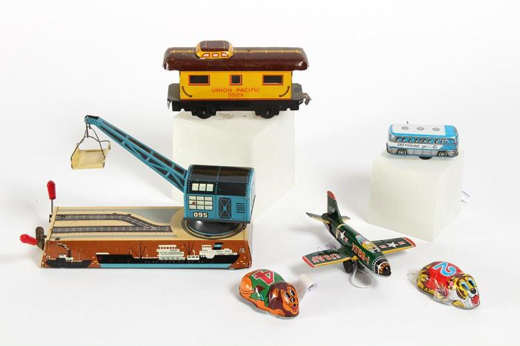 CRANES, PLANES, TRAINS, AND AUTOMOBILE TIN TOYS - Includes a Hans Biller West German 1950s Dock-Yard Crane lithograph tin toy with c...