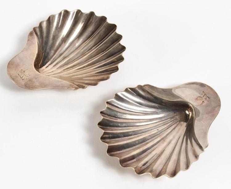 PAIR GEORGE III SHELL-SHAPED DISHES - With ribbed bodies; each with two conch shell feet; engraved with earl's crest. Made in London...