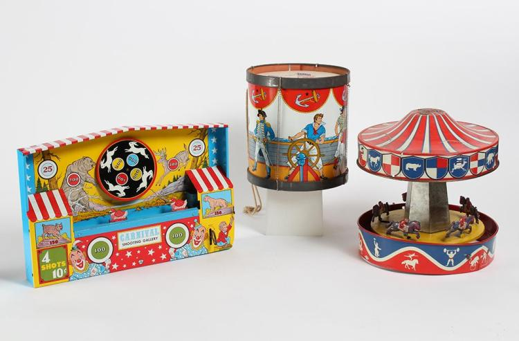 TIN TOYS - SHOOTING GALLERY, CAROUSEL, AND DRUM - Mid 20th century - Ohio Arts Carnival Shooting Gallery litho printed wind-up toy w...