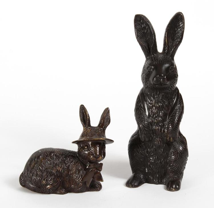TWO CAST METAL RABBIT FIGURES - Dark brown; both hollow with maroon felt covering the undersides.One standing, 13