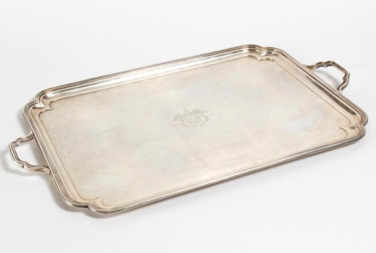 PETER GUILLE STERLING SILVER TEA TRAY - Rectangular form with concave corners and molded rim; having two loop handles. The center is...