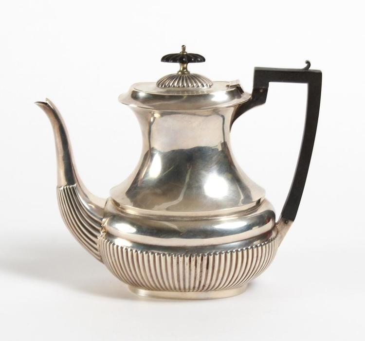 ENGLISH STERLING SILVER COFFEE POT – The lower body of the pot has a wide gadroon band which continues up the base of the swan-neck...