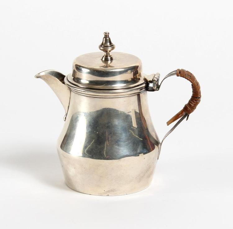 CRICHTON ENGLISH STERLING SILVER WATER JUG - Having a cylindrical body engraved on one side with the earl's crest, with a cane-wrapp...