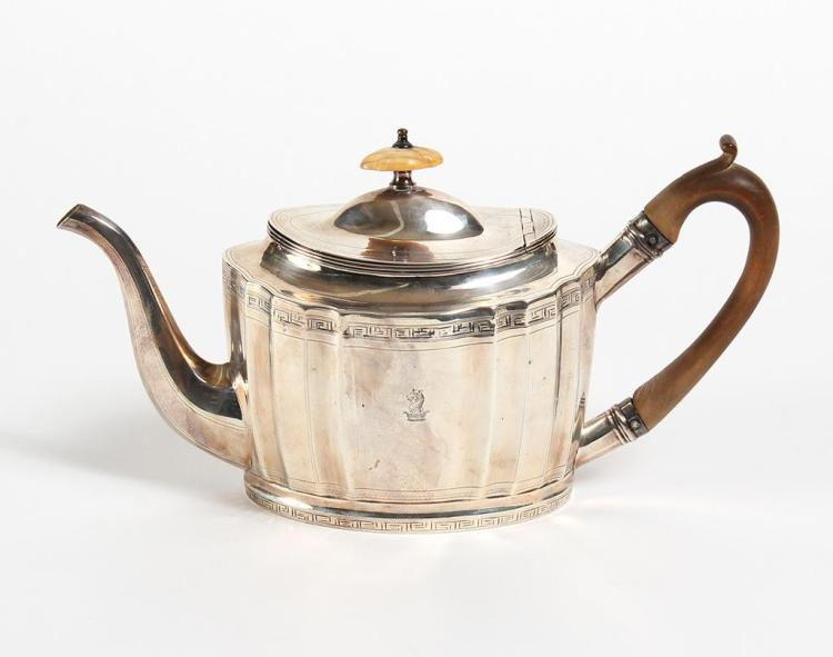 GEORGE III SILVER TEAPOT - Oval fitted form with key fret upper and lower borders within beaded lines. Engraved earl''s crest on two...