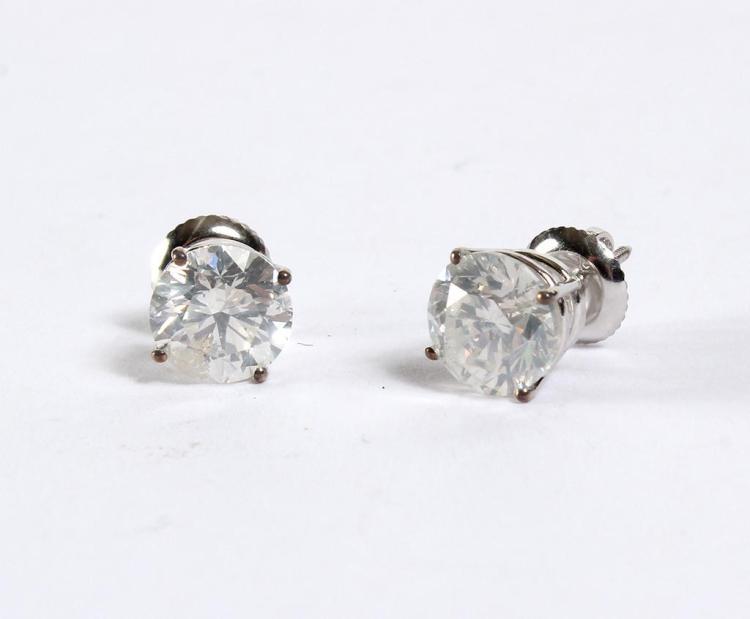 DIAMOND STUD EARRINGS IN 14 KT GOLD - Diamond solitaire earrings with screw backs