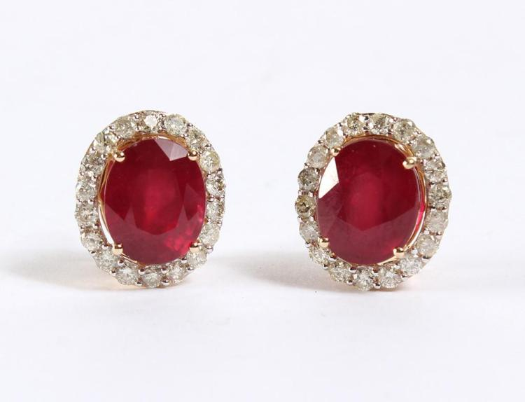 14 KT GOLD, DIAMOND & RUBY EARRINGS - Pair of rubies each set within a 14 kt yellow gold with rhodium accented diamond bezel which i...