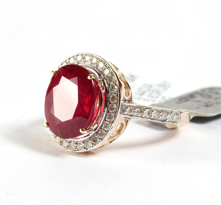RUBY & DIAMOND RING IN 14 KT GOLD - A 5.63 ctw. red ruby is set in a 14 kt yellow gold with rhodium accented diamond bezel which is ...