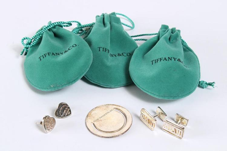 THREE SMALL TIFFANY & CO ITEMS - One, a pair of silver roman numeral cuff links (3/8