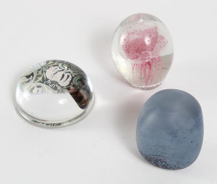 SET OF 3 GLASS PAPERWEIGHTS - Includes a frosted dark blue and black weight in an amorphic shape with a rich assortment of colors at...