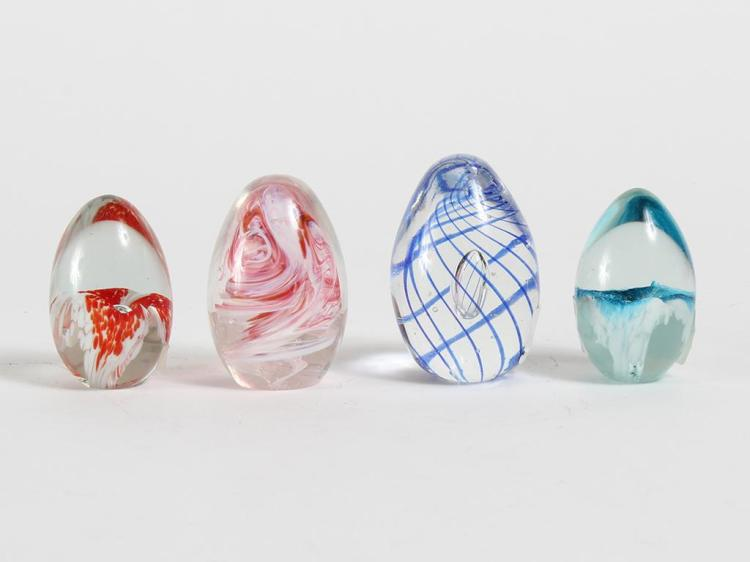 4 EGG-SHAPED GLASS PAPERWEIGHTS W/ 2 MT. ST. HELEN PIECES - Includes a blue and a red