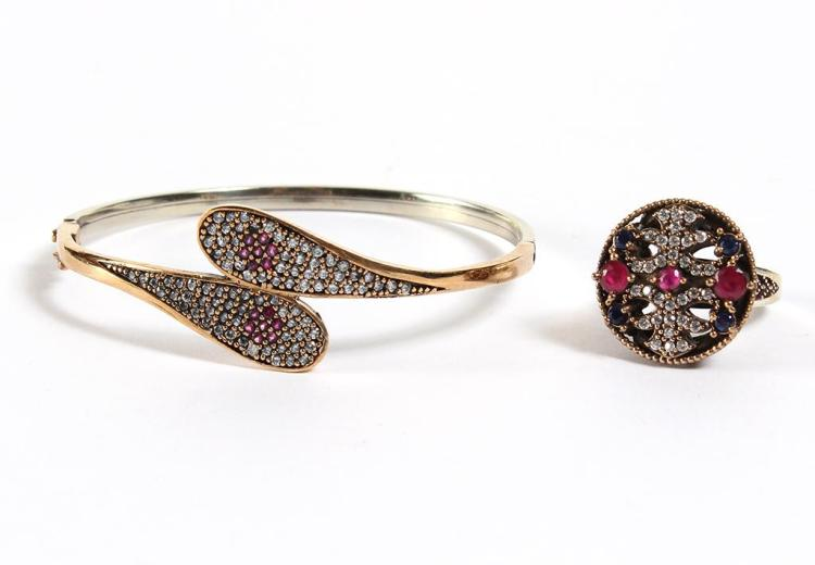 RUBY & TOPAZ BRACELET, RING OF RUBIES & TOPAZ - The pillbox style ring displays granulation technique metal work of bronzed sterling...
