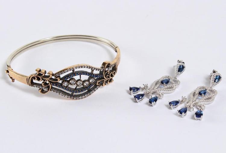 SAPPHIRE & WHITE TOPAZ BRACELET & EARRINGS - The hinged bangle bracelet is bronzed silver which at center splits into white topaz an...