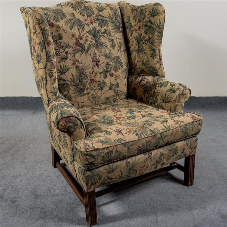 WING-BACK ARMCHAIR - Antique frame in the Georgian tall back manner with camel-back style crest, serpentine curved deep isolators, s...