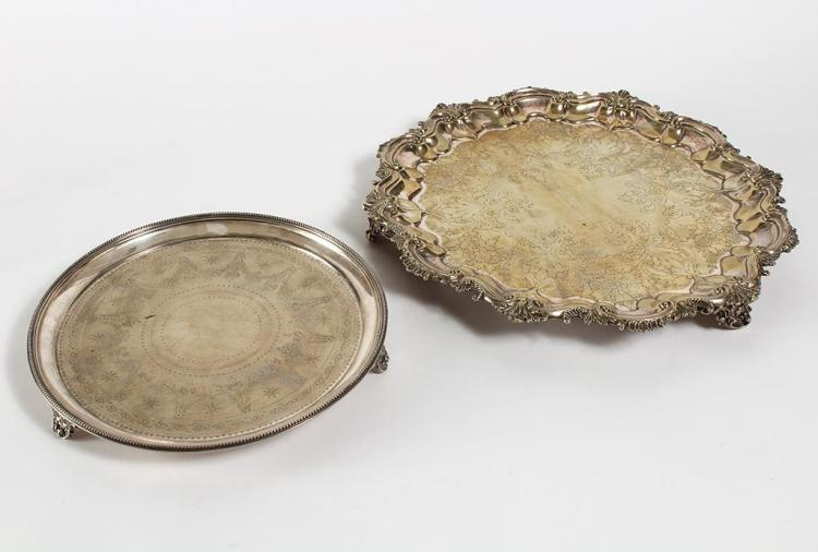 "TWO SILVERPLATE SALVERS – One is an Old Elkington plate salver tray (12"" diam.) on three shaped feet, the surface of which is engrav..."