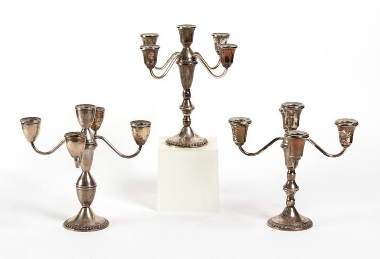 THREE 5-CANDLE STERLING SILVER CANDELABRA - The three are by the same maker, nearly identical in height and width, but each is a sli...