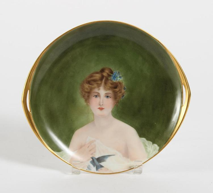 ROSENTHAL HAND PAINTED PORTRAIT PLATE - Portrays a beautiful woman holding a bluebird and having a sprig of blue flowers in her hair...