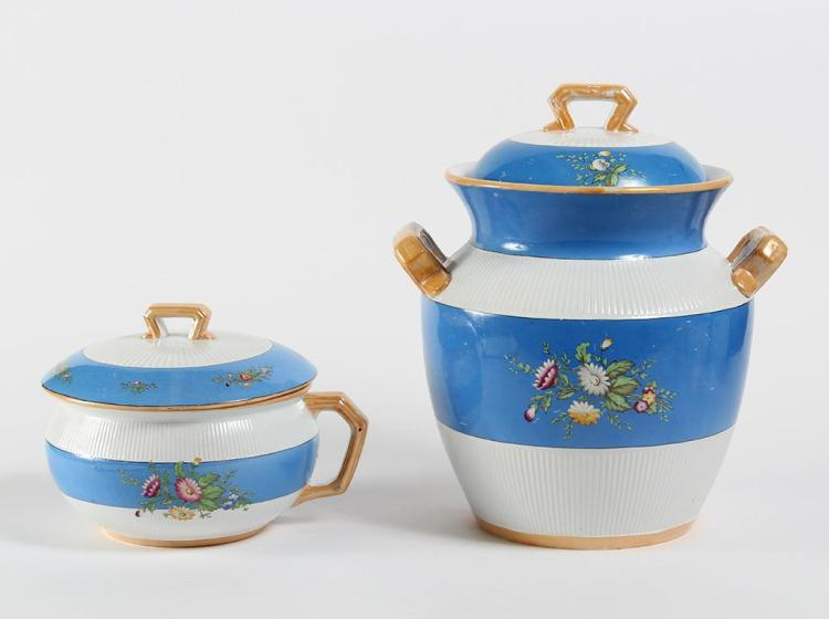 PAIR OF BLUE AND WHITE ENGLISH CHAMBER POTS - Early 20th century - Blue and white patterned chamber pots with match lids. Exterior o...