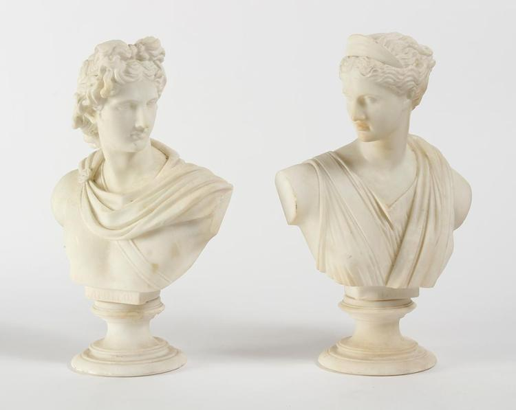 TWO SCULPTED ALABASTER BUSTS; APOLLO AND DIANA - White alabaster busts each on a socle; labeled