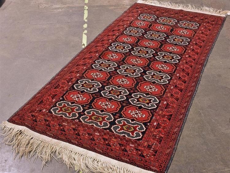 CARPET: HANDWOVEN AFGHANI BELOUCH - All wool with three rows of tarantula style devices alternating with stepped geometric crescent ...