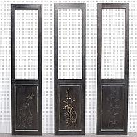 THREE ASIAN SCREEN PANELS - Three dark-stained wood screen panels. Lower portion of panels is incised front and back, with designs o...