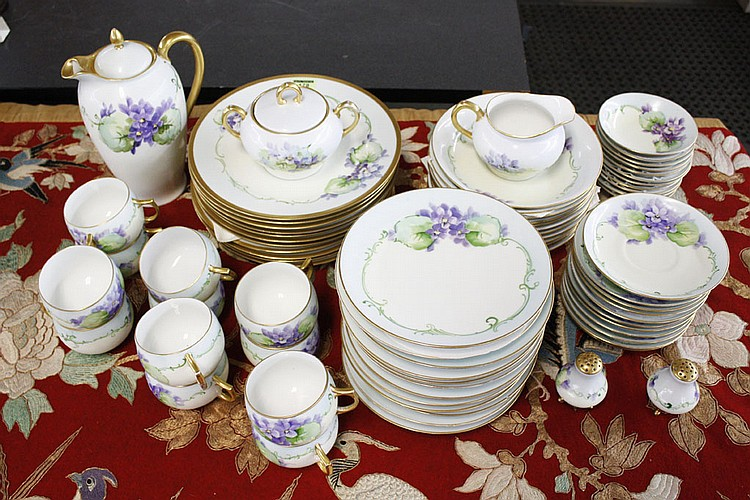GERMAN AND AUSTRIAN PORCELAIN DINNER SERVICE - 74 pieces dinner service to include dinner and salad plates, soup bowls, small sauce...