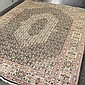 CARPET: HANDWOVEN PERSIAN NAIN - Wool on a cotton warp with Arabic inscription/signature, possibly of a master weaver, ring-style lo...