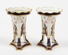 PAIR ROYAL CROWN DERBY PORCELAIN VASES - Having an amphora shape supported on a tripod stand and platform