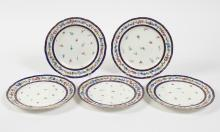 FIVE SEVRES PORCELAIN LUNCHEON PLATES - Decorated with sprigs of flowers on the plate floor and a band of flowers between two cobalt...