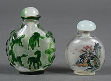 TWO CHINESE SNUFF BOTTLES - Peking glass snuff bottle with green horses on white ground on both sides of bottle. A reverse painted s...
