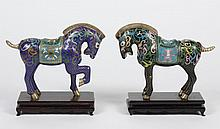 TWO CHINESE CLOISONNE HORSES - Both with scale pattern and flowers; one with cobalt ground; the second with black ground. Unmarked