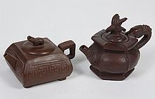 TWO CHINESE YIXING CLAY TEAPOTS - Comprising a square teapot with elephant lid finial; the second is a hexagonal shaped teapot with...