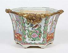 CHINESE PORCELAIN ROSE MEDALLION JARDINIERE - Footed and having a hexagonal shape with the traditional rose medallion pattern on eac...