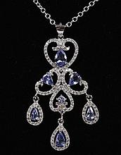 TANZANITE AND STERLING SILVER PENDANT - A trefoil motif pendant is set with 7 teardrop shape violet-blue tanzanite stones (total wei...