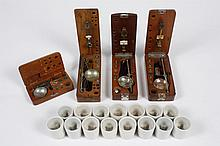 COLLECTION OF JEWELER'S SCALES - Four scales; each scale has a custom fitted wood box, together with a box of weights. From the Elli..