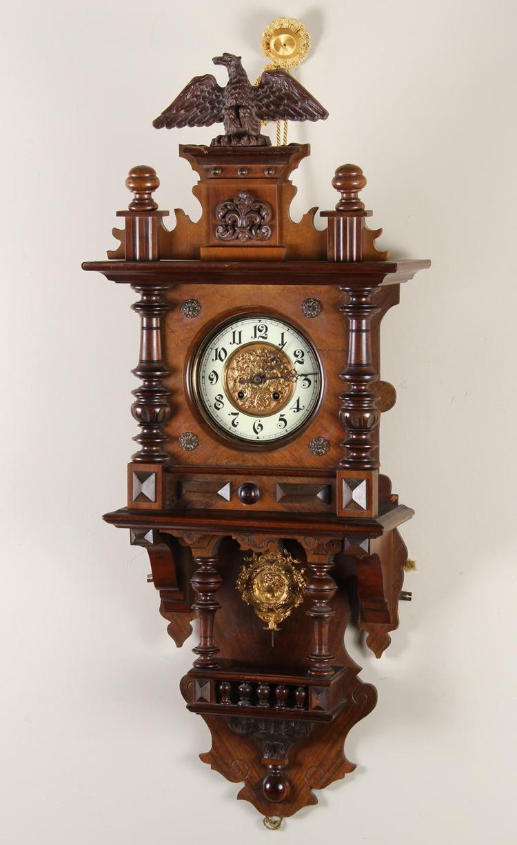 German wall clock with eagle carved finial walnut a