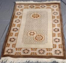 CARPET: HAND-KNOTTED CHINESE - Wool woven on cotton with stylized lattice and floral design on cream-colored field inside a peach bo...