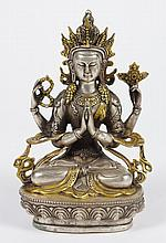 TIBETAN SILVERED AND GILT BRONZE FIGURE OF CHENREZIG - With two palms together holding a wish fulfilling gem; Chenrezig's other hand..