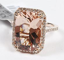 MORGANITE AND DIAMOND RING - This beautiful rectangular cushion-cut natural 7.4 ct morganite stone is set within a diamond bezel, sup..