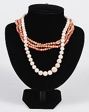 TWO CORAL NECKLACES - One is a pale shade of coral graduated size bead necklace (18