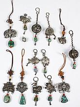 TWELVE CHINESE OR NEPALESE SILVER METAL CHARMS - A delightful collection of tinkling charms, perhaps hung on horse or donkey bridles...
