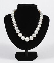WHITE SOUTH SEAS PEARL NECKLACE - Graduated strand of cultured pearls, 10.0 to 16.5 mm in size, individually knotted, terminating in...