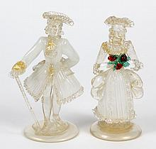 MURANO GLASS FIGURINES - Portray a man and woman in 18th century court dress complete with tricome. Glass is accented with small whi...