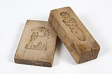 TWO WOODEN BUTTER OR COOKIE MOLDS - Comprising a rectangular mold with a figure and a double sided mold of a sheep and a goat. One m...