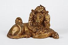 VINTAGE CAST PLASTER FIGURE OF A RECUMBENT LION - Gilded and regal in a reclining position