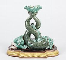 ANTIQUE WEDGWOOD MAJOLICA DOLPHIN CANDLESTICK - Two Dolphins with entwined tails rest on a semi oval base. Interior cup of candlesti...