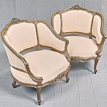 PAIR OF ANTIQUE BERGERE ARMCHAIRS - Vienna Baroque style chairs with floral and shell style high relief crests, carved armrests with...