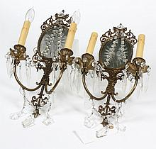 PAIR OF ANTIQUE BRASS AND CRYSTAL WALL SCONCES - Two of two pair. Two arms with starburst cut mirror backs, crystal swags and prisms...